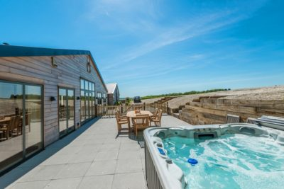 A stunning hot tub and views outside our party house Silverbirch at Wallops Wood Cottages 1.jpg