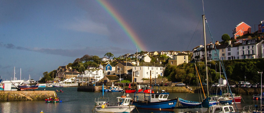 Brixham bay with a rainbow over it